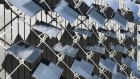 A 'skin' of movable solar panels helps buildings keep their cool