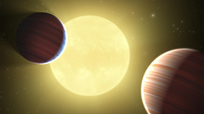 Illustration showing two Saturn-sized planets crossing in front of their star, Kepler-9.